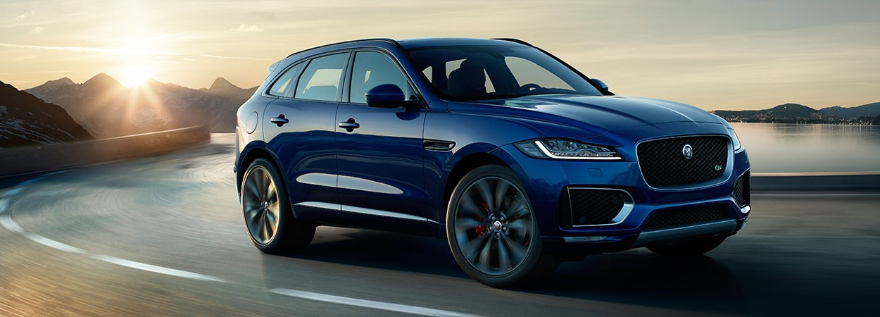 The new Jaguar F-Pace in Dark Sapphire Blue - Side View