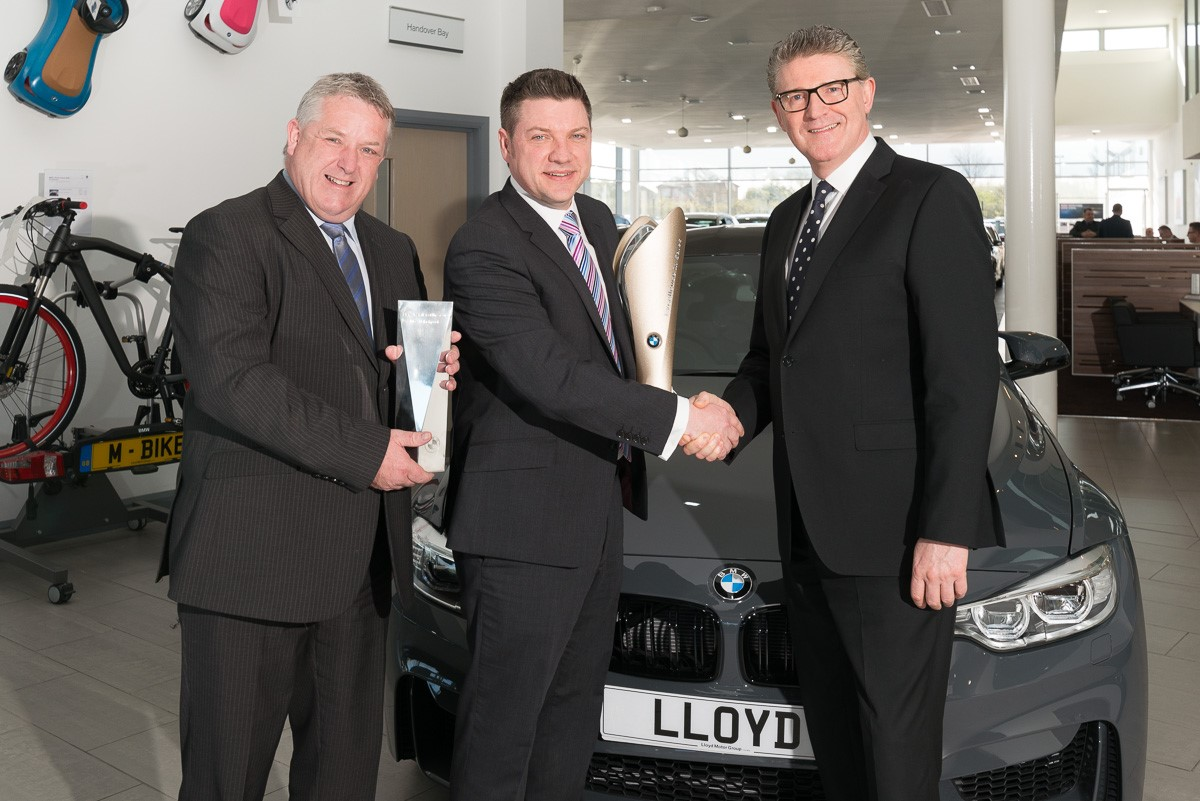 Lloyd BMW Blackpool wins BMW Retailer in Customer Care' at the prestigious worldwide 2016 BMW Excellence in Sales Awards, held in Munich. Photos: Lloyd  BMW Franchise Director Gary Bingley, Head of Business Mark Powell and CEO of BMW Graham Greaves