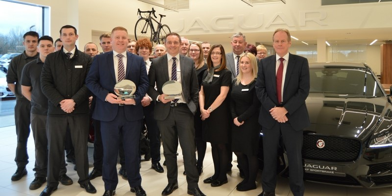 Staff from Lloyd Jaguar celebrating winning best Jaguar dealer in the UK award