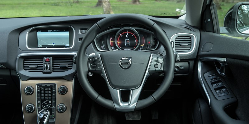 New Volvo V04 interior shot of steering wheel. Copper inlays and dashboard