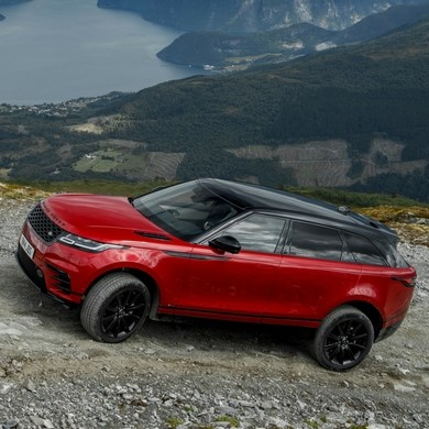 New car offer with a Range Rover Velar pictured on hillside overlooking lake