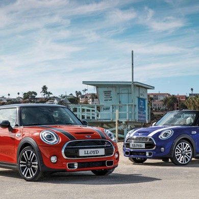 two new MINIs parked up with sales offers available