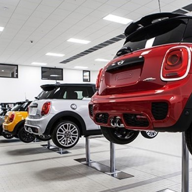Cars in MINI Service Centre on raised workshop ramps