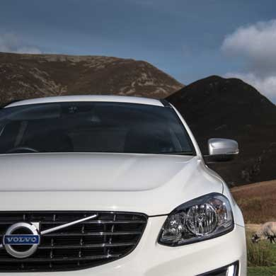 White Volvo xc60 with background of buttermere